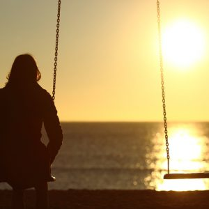 Woman watching sunset for solace