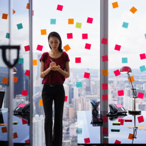 Woman in office with reminders
