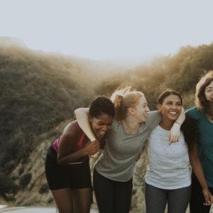 women hiking and feeling healhty