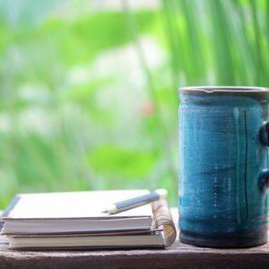 Notebook and coffee mug