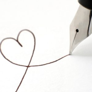 Pen drawing a heart