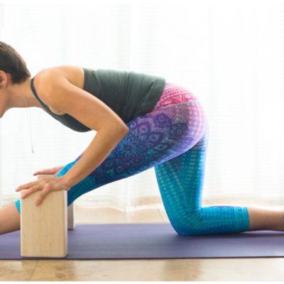 Half-hanumanasana yoga pose with blocks