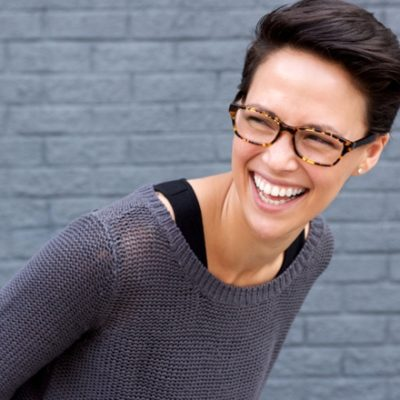 Woman smiling in gray sweater