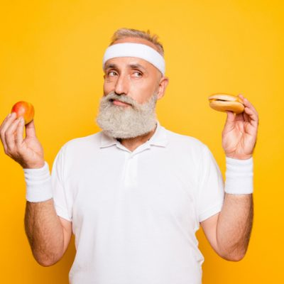 Man holding up food wondering if the vegan recipe will taste like the real thing.