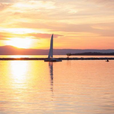 Sailboat on still lake