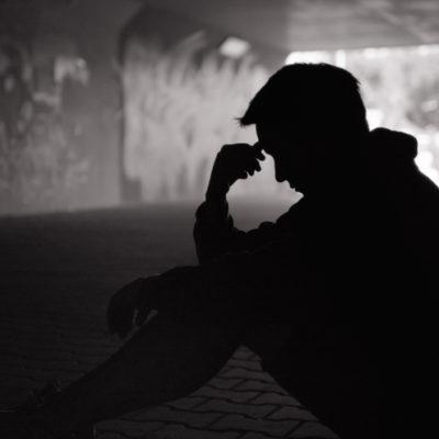 Sad young man struggling with self-esteem