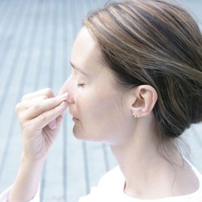 woman doing alternate nostril breathing
