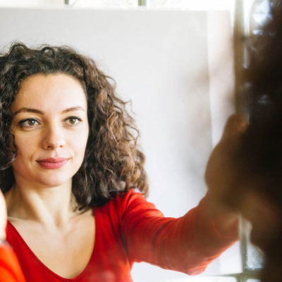 Woman talking to herself in mirror