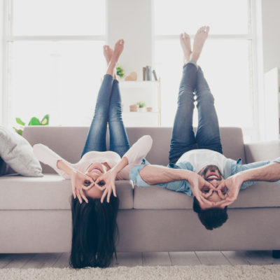 Couple laying upside down on couch