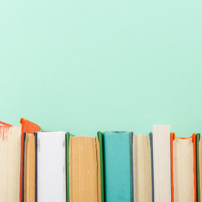Books on teal background