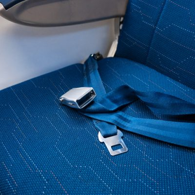 Airplane fasten your seatbelt before assisting others