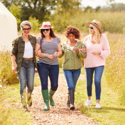 group of female friends on retreat walking together