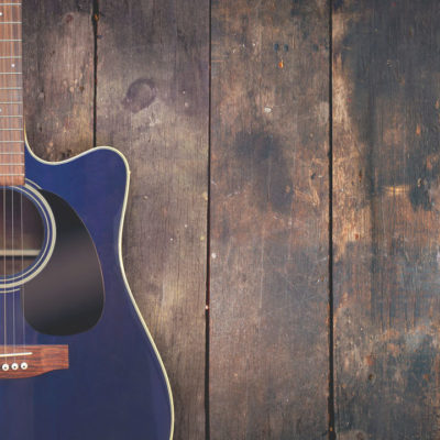 Guitar on wood background