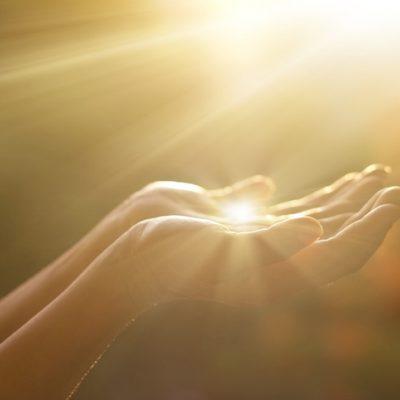 Ho'oponopono praying hands holding light