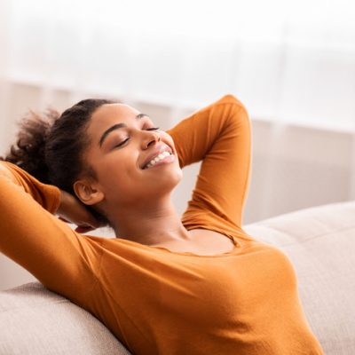 woman relaxed on couch lessen fear