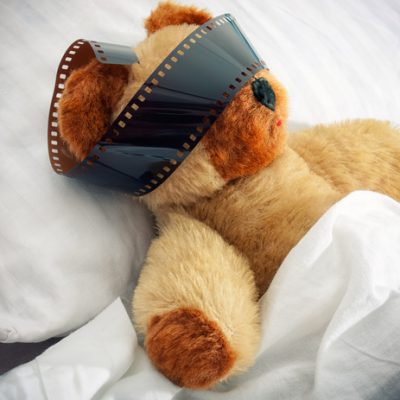 teddy bear with camera film over eyes for lucid dreaming how to lucid dream