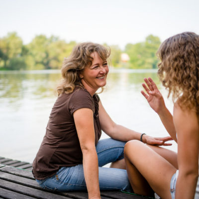 Two women talking on a dock