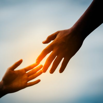 reaching out hands god helping