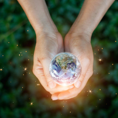Woman holding glowing globe