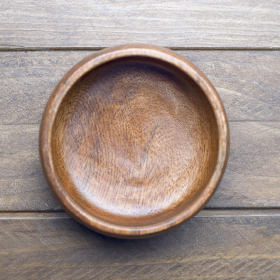 A simple wooden bowl illustrates how containers matter as much as what goes in them