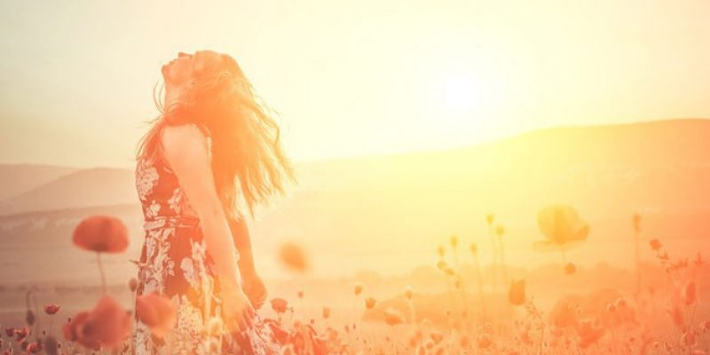 Woman embracing sunlight