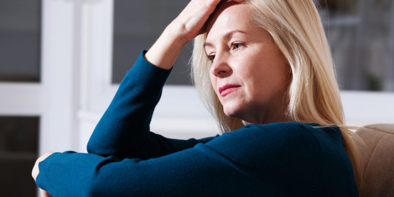 An anxious woman is deep in thought