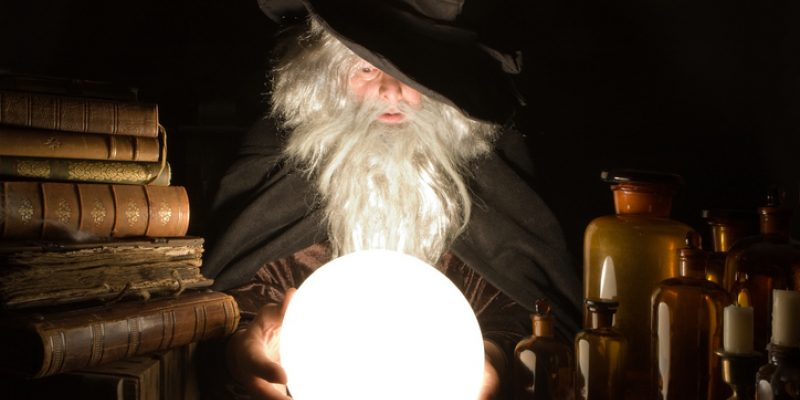 Wizard looking into the future with a crystal ball.