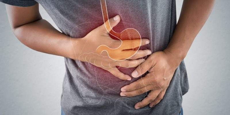A man clutches his painful stomach