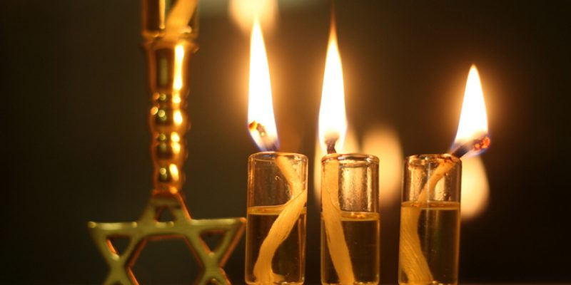 On the third night of Chanukah, three small oil cups are have been lit.