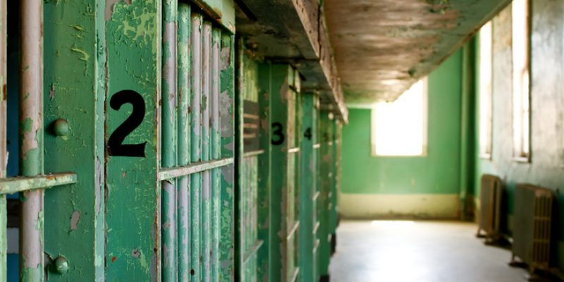 A historic prison with old, worn-down jail cells.