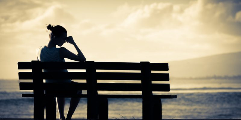 Lonely Woman on Bench