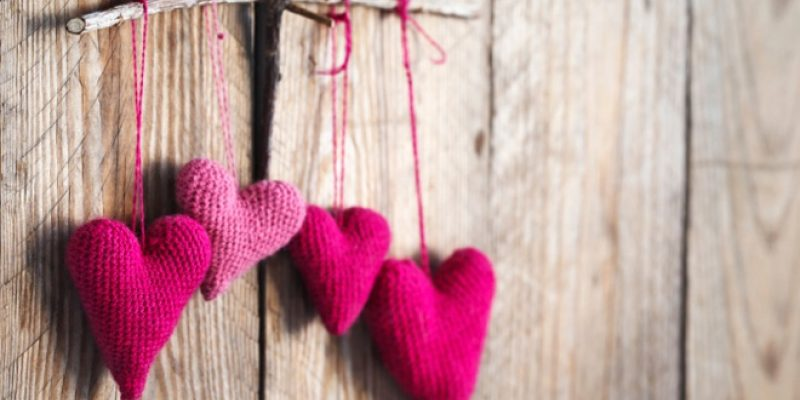 Crocheted hearts on wood wall