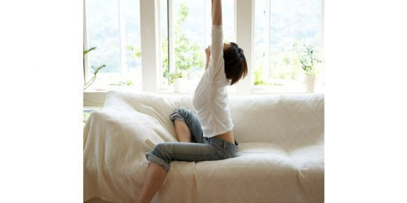 Woman stretching in bright room