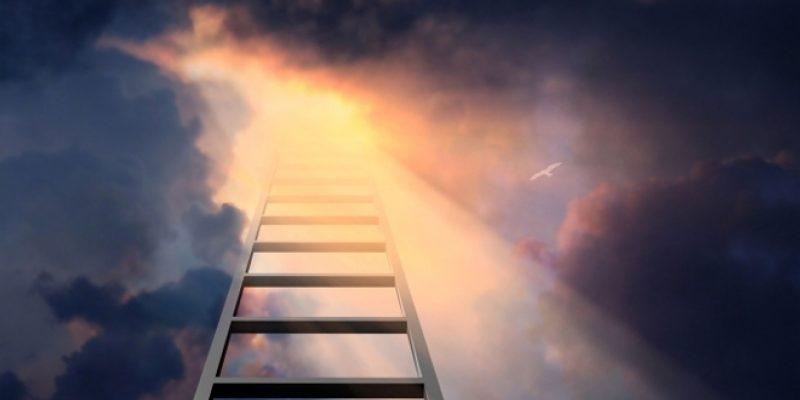 Ladder climbing to dramatic sky