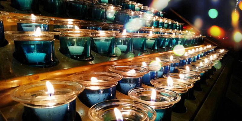 Candles in a church illustrate the spiritual aspect of Halloween