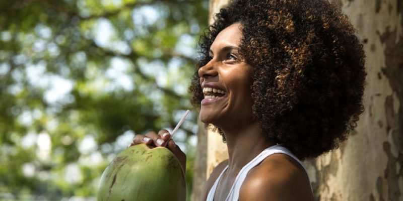 Woman drinking coconut water