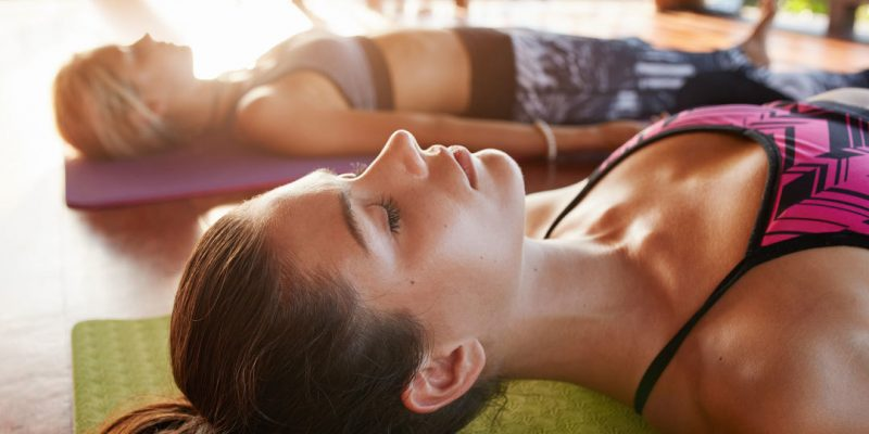 Woman in savasana yoga pose