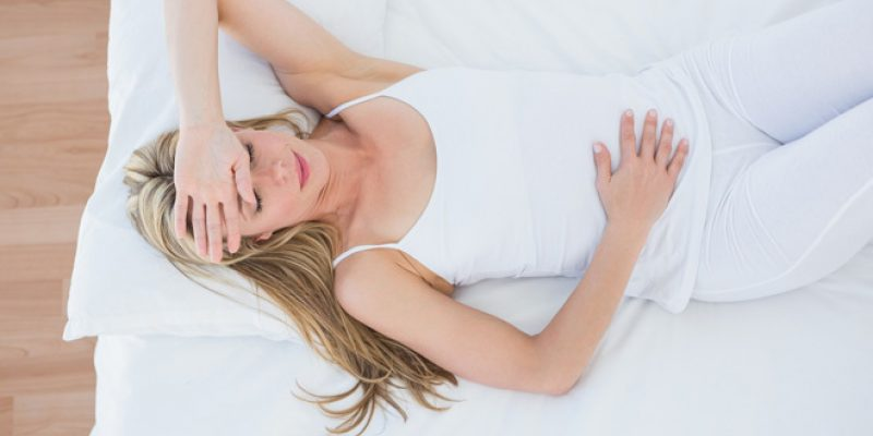 woman lying down with hand on stomach