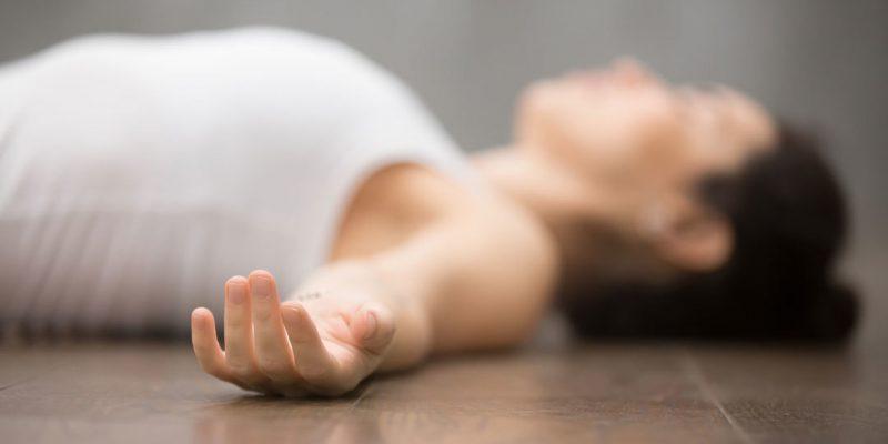 Woman relaxing in savasana