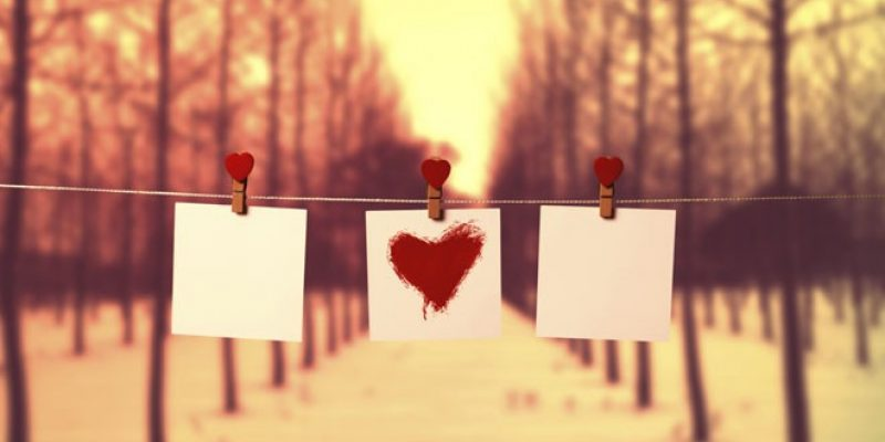 Paper heart on string in woods