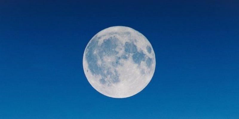 Full moon on a dark blue night sky
