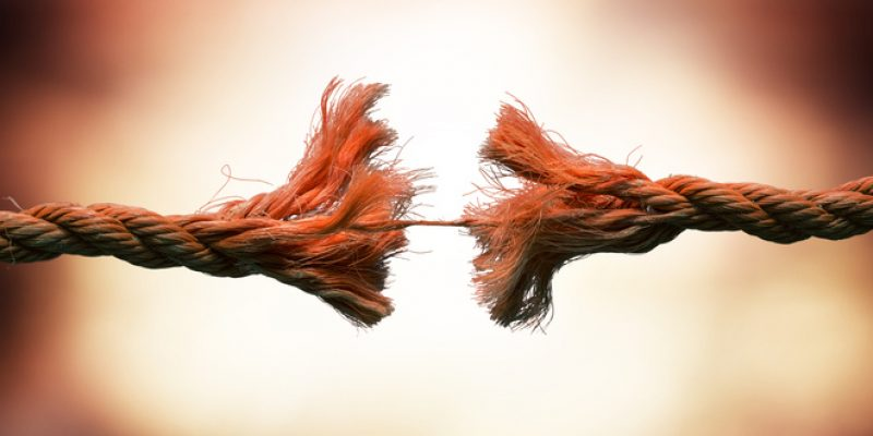 A frayed rope about to break showing the concept of tension and overwhelm