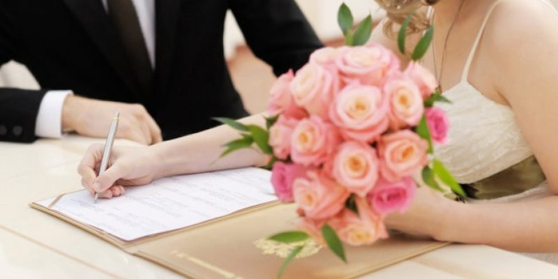 signing marriage document