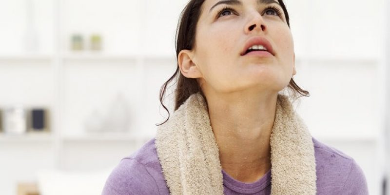 Sweating woman shows spiritual meaning of sweating