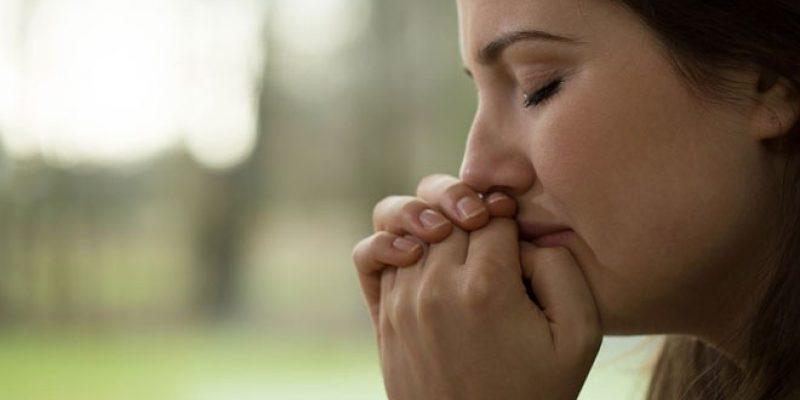 Woman crying outdoors for no reason, empath, empathy