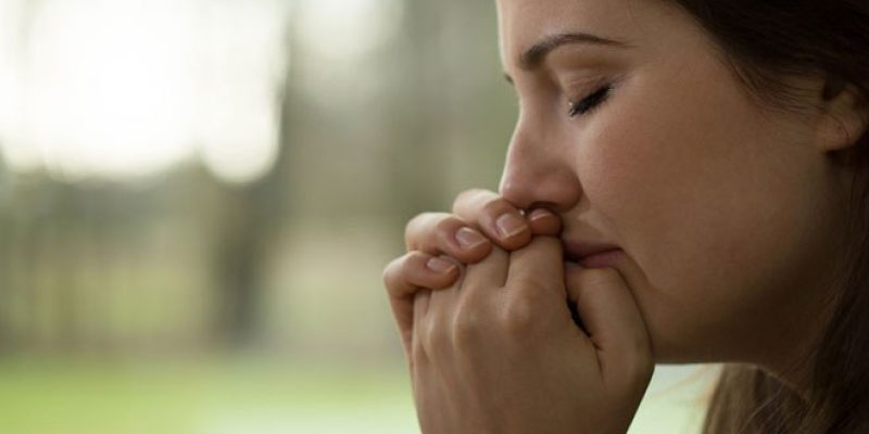 Woman crying outdoors for no reason, empath