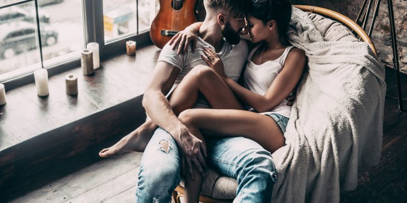 Couple intimate on chair