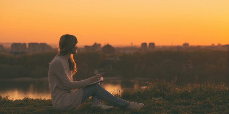 women writing at sunset