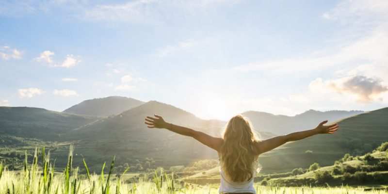 young woman emotionally clean and detoxed, feeling refreshed in the morning outdoors