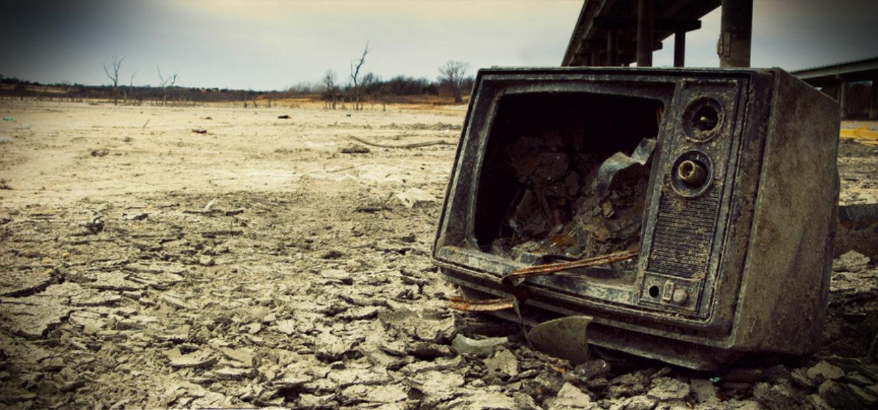 Broken TV sitting in a barren wasteland